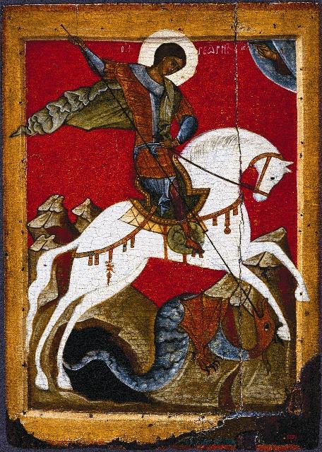 Верхом на белом коне, в голубой мантии и серебряных доспехах, поражающий копьем огромного змея, Георгий Победоносец изображен на флаге и гербе столицы